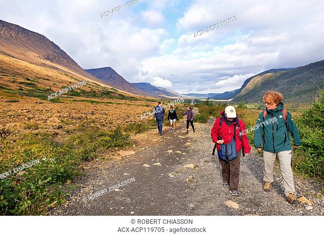 Parks Canada interpreter Kristen Oravec leading a small group of visitors along the Tablelands Trail in Gros Morne National Park, Newfoundland, Canada