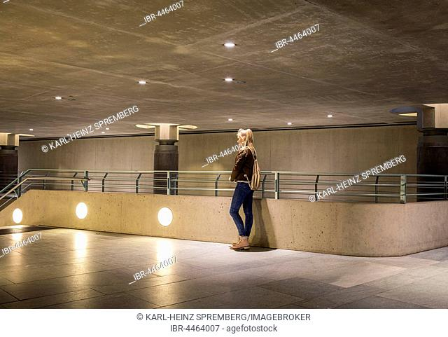Teenager, young girl alone, entrance to underground station, Berlin, Germany