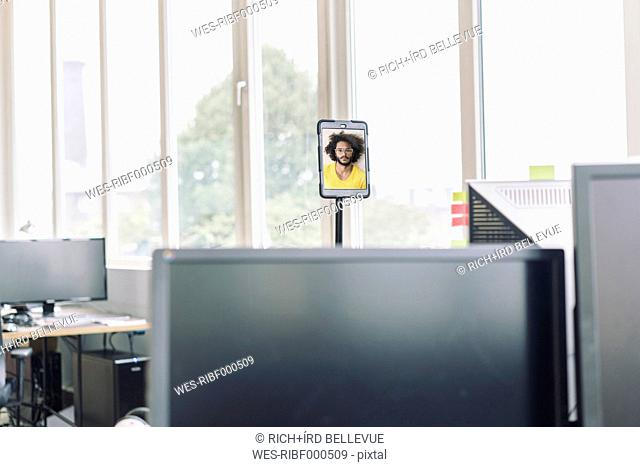 Video conference in empty office room with computers