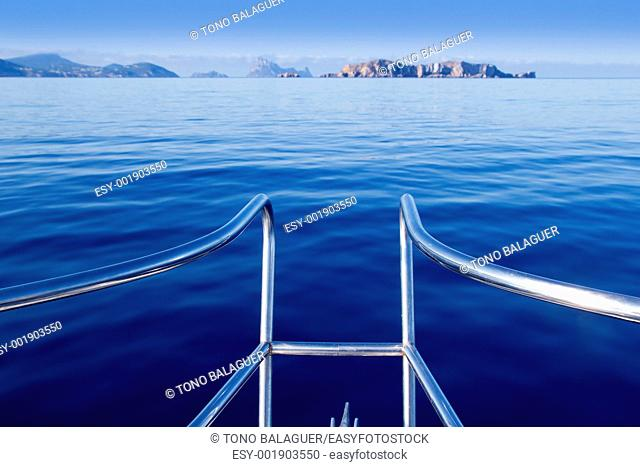 Boat bow in ibiza sailing to Esparto island with Es Vedra background