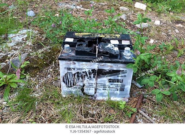 broken car battery in nature