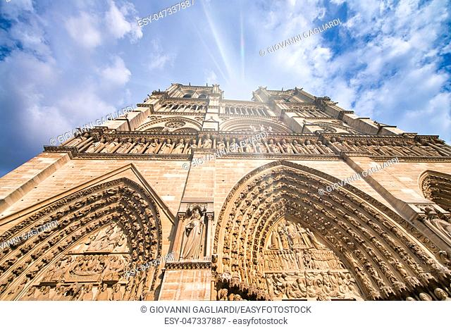 Notre Dame Cathedral facade against a beautiful blue sky, Paris - France