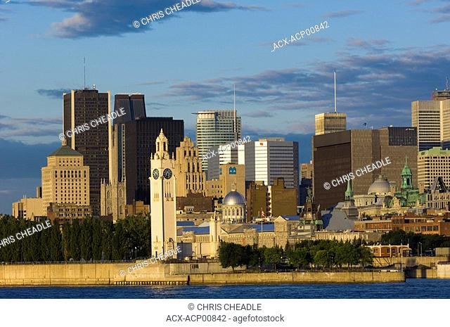 Early morning view of skyline with old Montreal in foreground, across St  Lawrence River, Montreal, Quebec, Canada