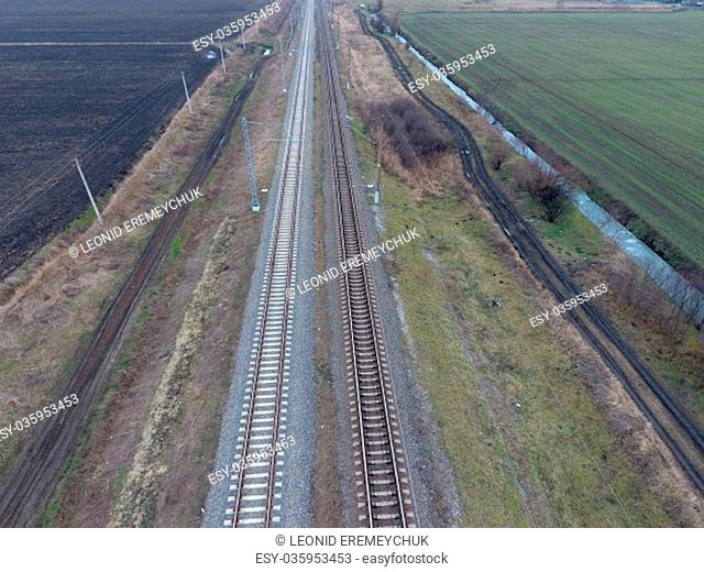 Plot railway. Top view on the rails. High-voltage power lines for electric trains
