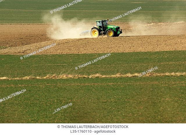 heavy tractor working on a field in Lower Saxony, Germany, near Goslar