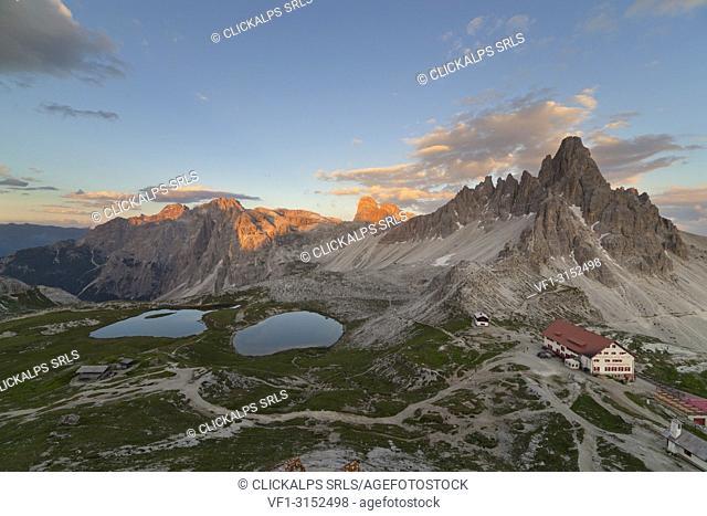 Sunset on Paterno Mount and Piani Lakes with Locatelli-Innerkofler refuge, Dolomites, Dobbiaco, South Tyrol, Bolzano, Italy