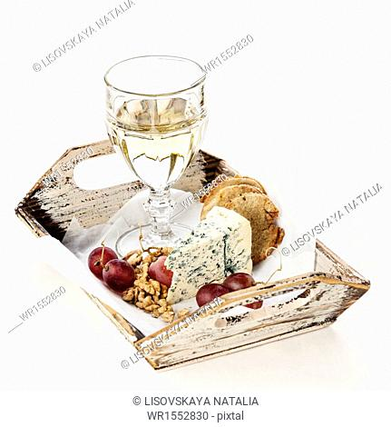Snacks Dor Blue cheese, nuts, grapes and wine on tray