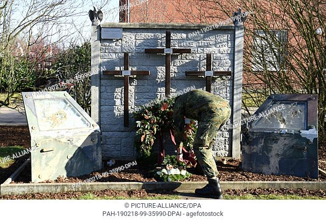 """18 February 2019, Lower Saxony, Seedorf: In the barracks of the paratrooper regiment 31 a soldier takes care of the wreath at the memorial """"""""Memorial of the 3rd..."""
