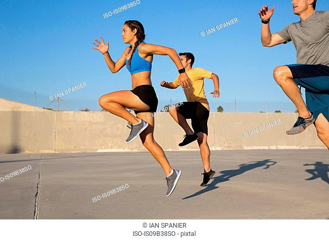 Athletes doing high knees exercise, Van Nuys, California, USA