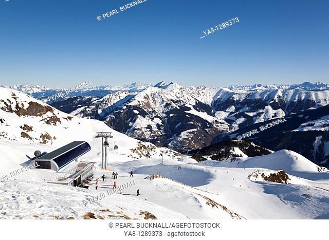 Rauris Austria Europe  Gipfelbahn summit gondola station at the top of the Rauriser Hochalmbahnen ski runs in ski resort in Austrian Alps in winter  Distant...