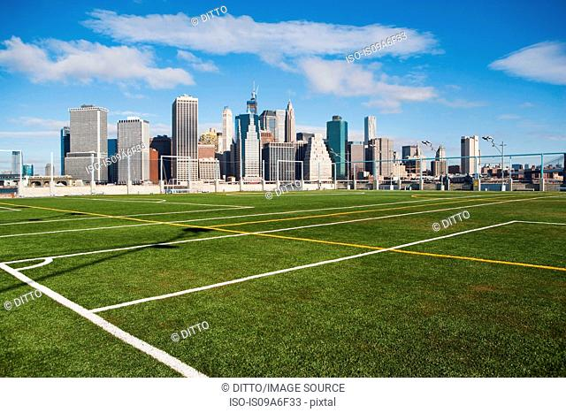 Soccer fields and Lower Manhattan skyline, New York City, USA