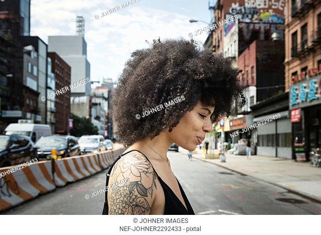Smiling woman looking crossing street