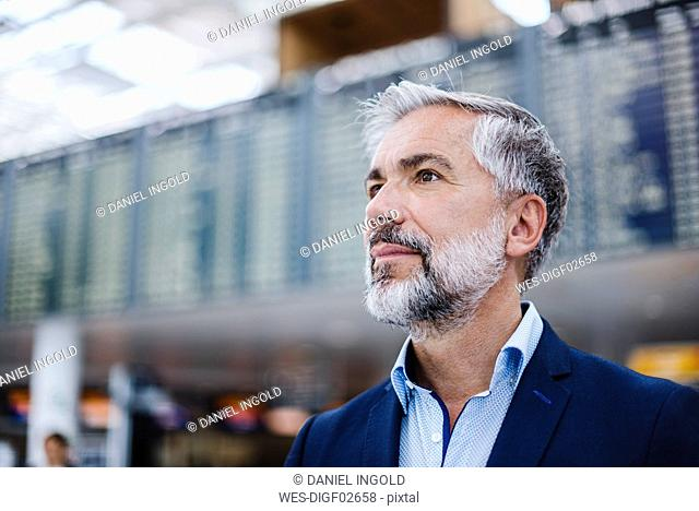 Portrait of confident businessman at a station