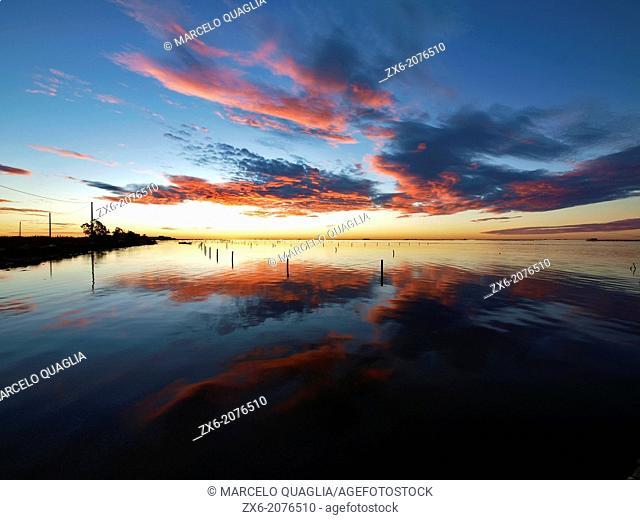 Twilight before sunrise at Alfacs Bay. Ebro River Delta Natural Park, Tarragona province, Catalonia, Spain