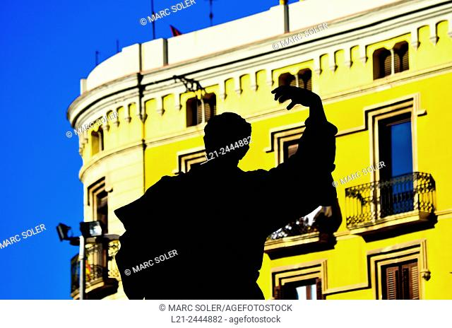 Black silhouette of the statue dedicated to Pau Claris. Detail silhouetted against a yellow building. Arc de Triomf, Barcelona, Catalonia, Spain