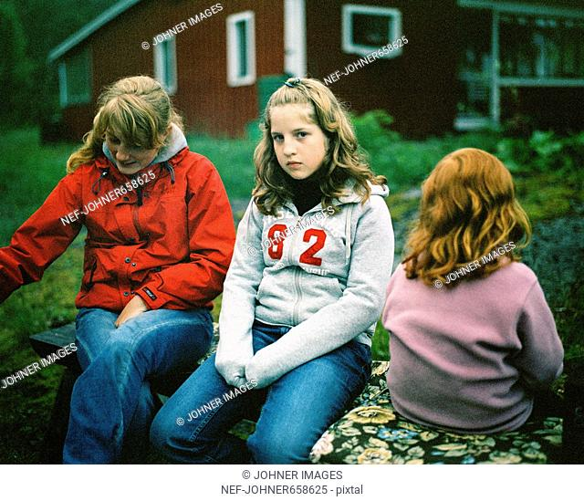 Three people on a bench, Angermanland, Sweden