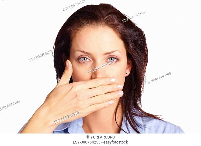 Speak no evil - Attractive woman covering mouth with her hand while looking at you over white