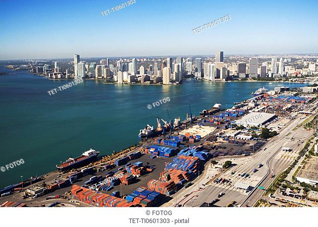 Aerial view of waterfront city and port