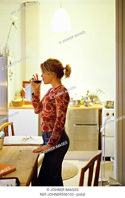 A woman drinking a glass of wine, Sweden
