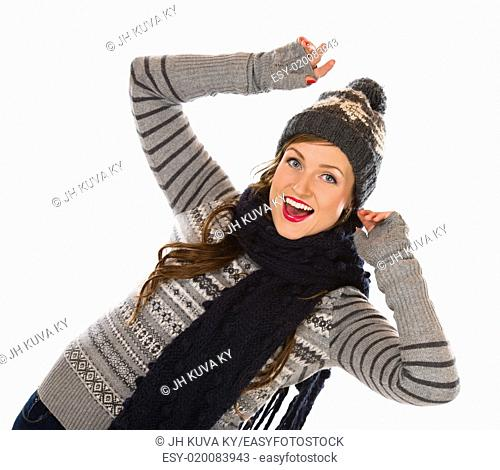 Beautiful young woman wearing woolen outfit, white background
