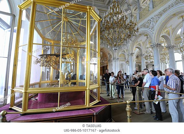 Visitors view the newly renovated Peacock Clock by James Cox in the Pavilion Hall of the State Hermitage Museum, St Petersburg in Russia on 28th July 2009