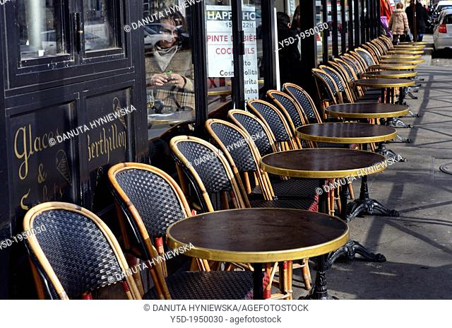 rows of chairs and tables in front of restaurant, old town, Paris, France