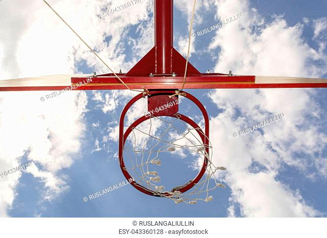 Bottom view of Basketball hoop with blue sky background