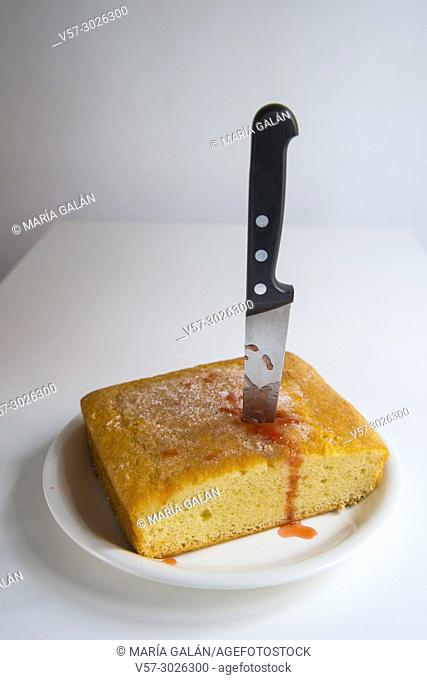 Cake stabbed by a kitchen knife