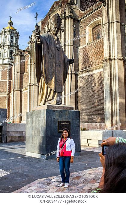 Pilgrims, Statue of Pope John Paul II and Old Basilica Our Lady of Guadalupe, Mexico City, Mexico