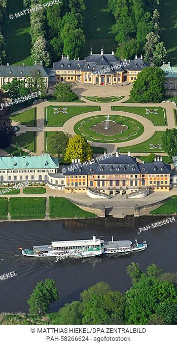 The passenger steamship 'Leipzig' built in 1929 moves past Pillnitz Castle in Dresden, Germany, 11 May 2015. The palace, which was rebuilt by Augustus II the...