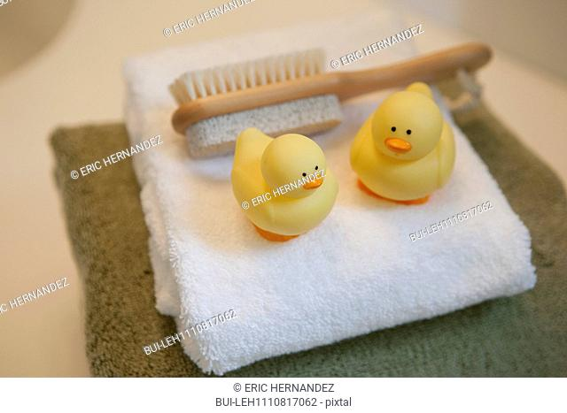 Close-up of towel with brush and rubber ducky