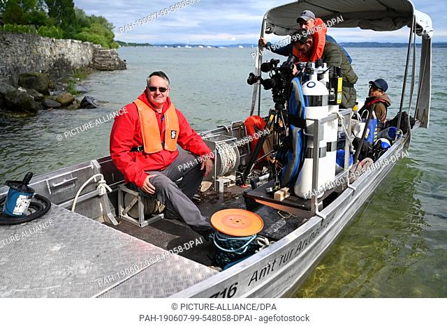 06 June 2019, Switzerland, Uttwil: Archaeologist Urs Leuzinger (l) from the Department of Archaeology in Frauenfeld, sits on a boat and immediately afterwards...