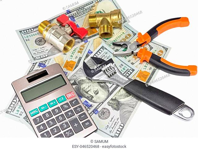 calculator and plumber tools on banknotes background