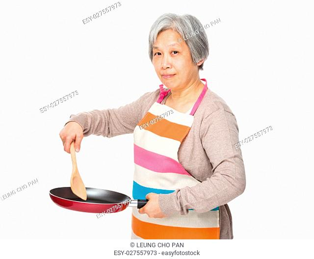Asian old housewife making food