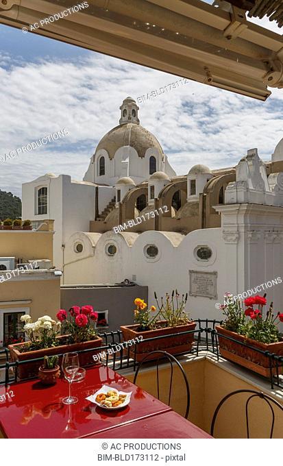 Restaurant balcony over Capri cityscape, Amalfi Peninsula, Italy