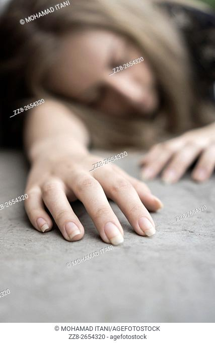 Dead woman on the ground outdoors