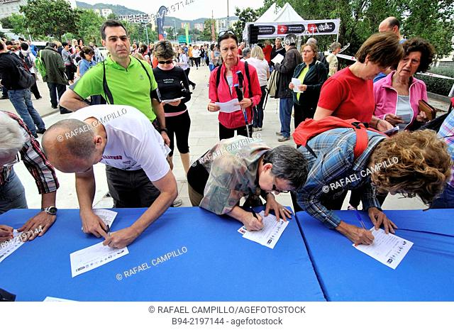 Signing up for popular walk. Gracia district. Barcelona. Catalonia. Spain