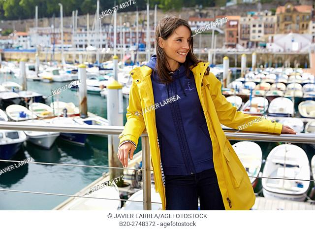 Young woman with waterproof, Port, Donostia, San Sebastian, Gipuzkoa, Basque Country, Spain, Europe