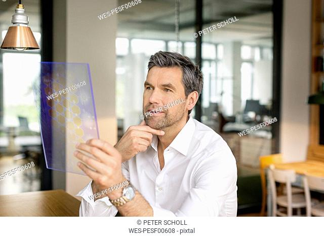 Businessman using futuristic portable device