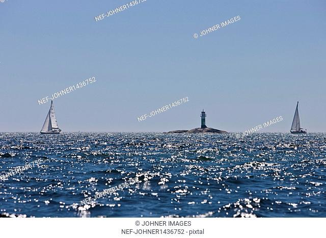 Sailboats and lighthouse
