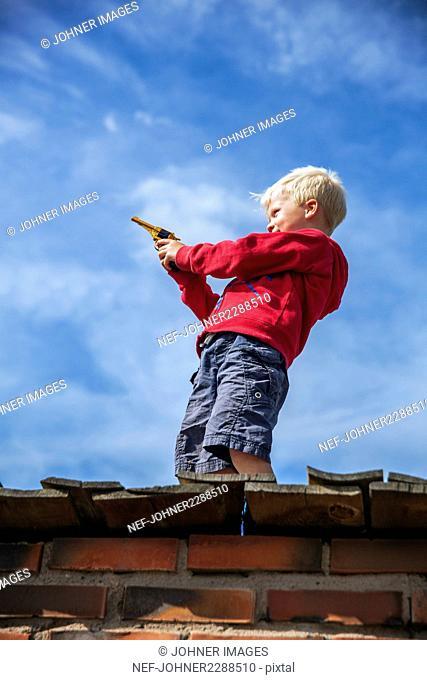 Boy playing with gun