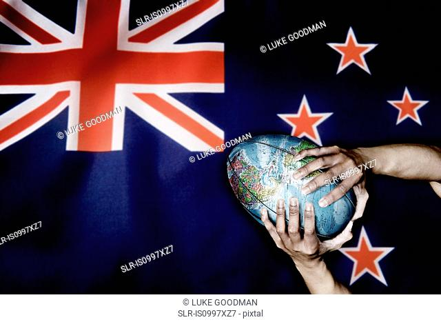 New Zealand flag and world rugby ball