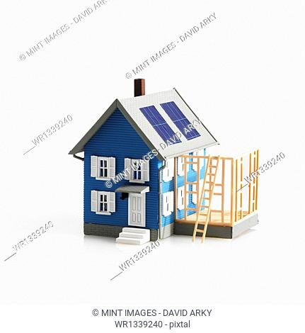 A model of a traditional house, with terrace or framework of an extension