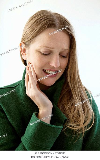 PAINFUL TOOTH IN A WOMAN