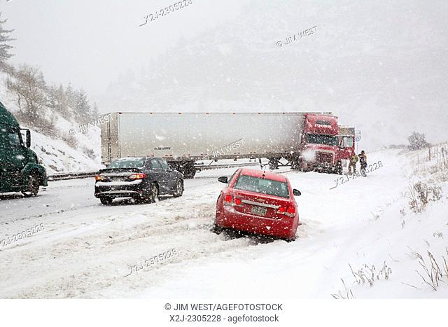 Vail, Colorado - A jackknifed truck blocks the westbound lanes of Interstate 70 during a snow storm in the Rocky Mountains