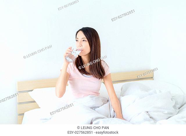 Asian Woman drink of water