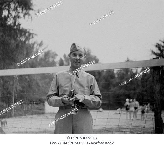 Soldier in Uniform in Front of Volleyball Net, Portrait, WWII, HQ 2nd Battalion, 389th Infantry, US Army Military Base, Indiana, USA, 1942