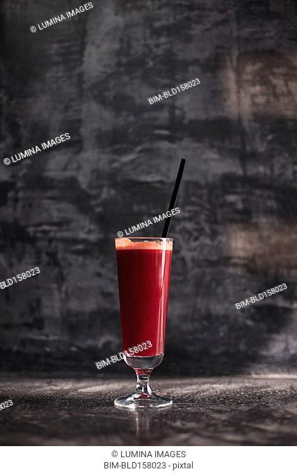 Close up of glass of healthy red juice
