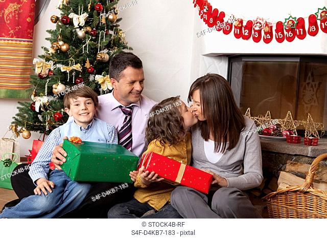 Family with two children at Christmas tree