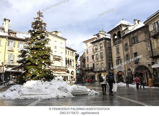 Christmas decorations at the Market Square after the snowstorm. Domodossola, Piedmont. Italy